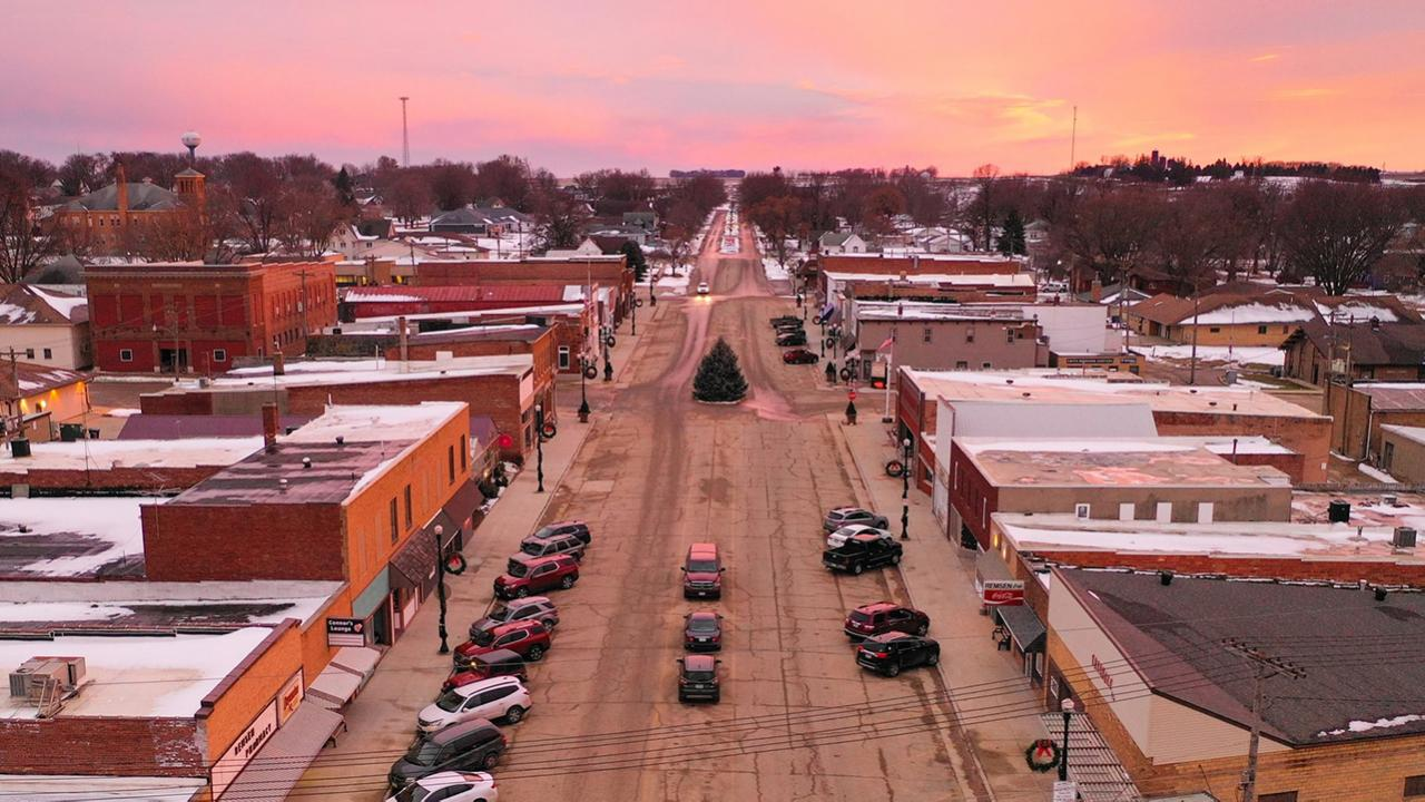 Drone shot of main street in small town.